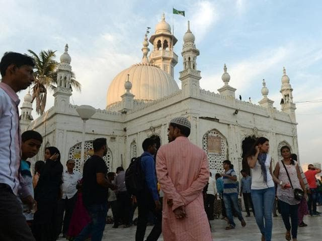 Visitors are seen inside the Haji Ali dargah in Mumbai. A landmark mosque in Mumbai is facing pressure to overturn a ban on women.