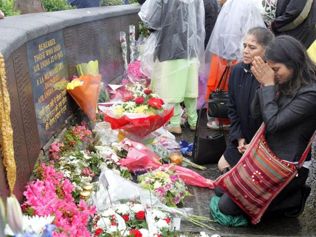Victims' relatives offering prayers at the Kanishka memorial on the 20th anniversary of the bombing in Ahakista, Cork, Ireland, on June 23, 2005.