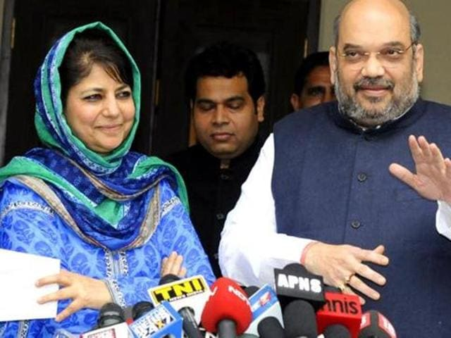 BJP president Amit Shah and PDP chief Mehbooba Mufti address a press conference in New Delhi.