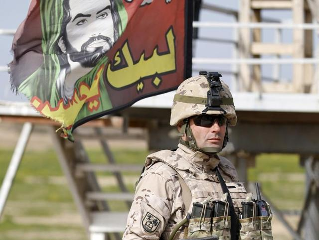 US led coalition instructors monitor as they train Iraqi soldiers in south of Baghdad, Iraq. At least 18,800 civilians were killed and 36,240 wounded in violence in Iraq from January 2014 to October 2015, according to the United Nations.