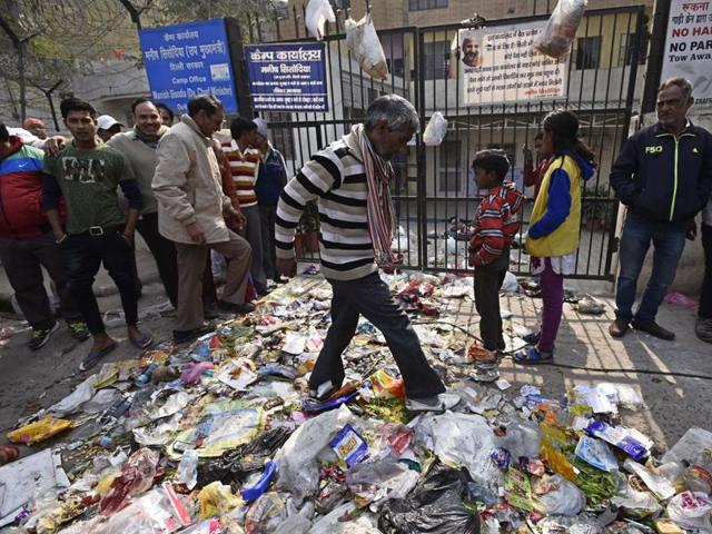 MCD workers place mounds of garbage outside Delhi Deputy Chief Minister, Manish Sisodia's residence at Mayur Vihar during their protest over non-payment of salaries, in New Delhi, India, January 28, 2016.