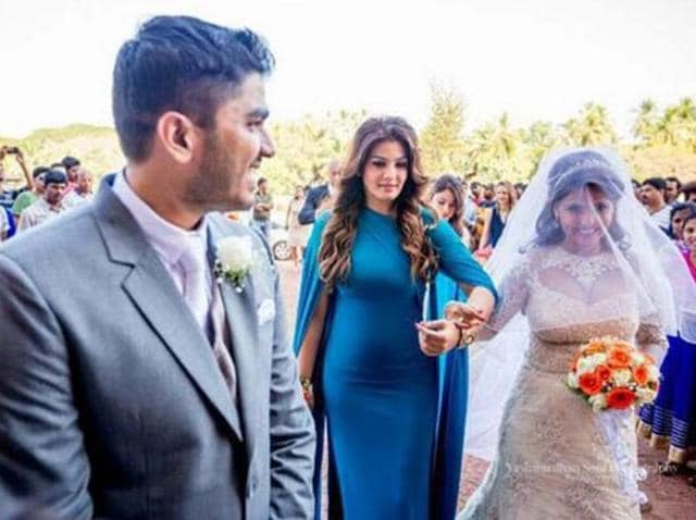 Chhaya looked pretty in a white lacy wedding gown, complete with a veil. Raveena was seen wearing a superfit, body-hugging electric blue gown which had a cape-like effect to it.