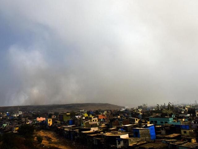 Smoke coming out from Deonar dumping ground which spreads in the adjoining areas leaving polluted air to breathe in Mumbai on Friday.