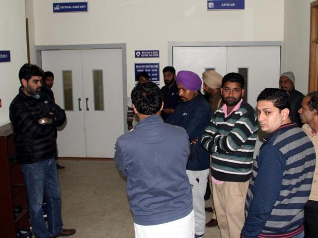 Relatives standing outside the ICU as Gurdas Singh Badal undergoes treatment at the Jindal Heart Institute in Bathinda on Saturday.