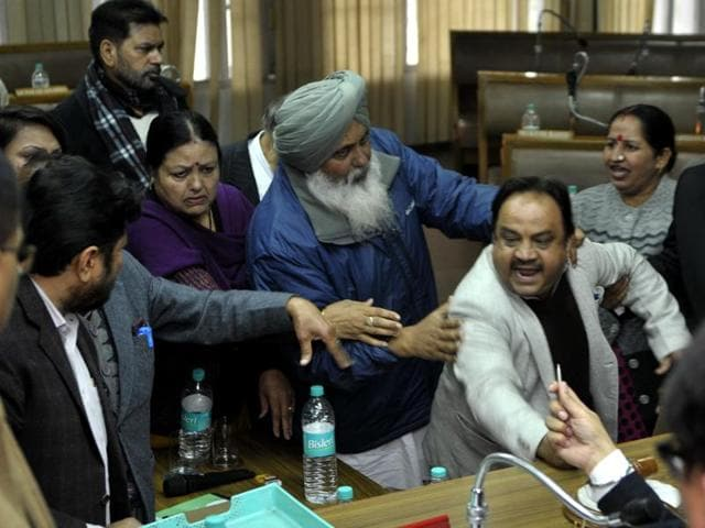 Congress and BJP councillors having a verbal duel during the MC House meeting in Chandigarh on Friday.