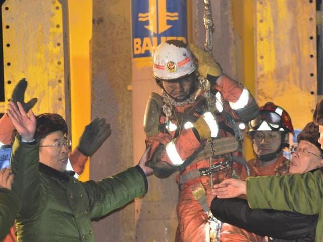 Trapped worker is lifted from a collapsed gypsum mine after 36 days of rescue, in Pingyi, Shandong province, January 29, 2016.