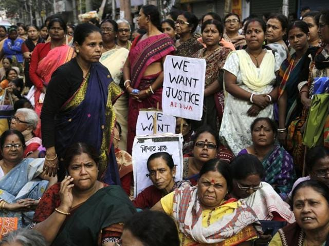 Women activists participate in a demonstration demanding highest punishment for convicted persons in the Kamduni rape case and the re-arrest of two acquitted persons near the city court in Kolkata.