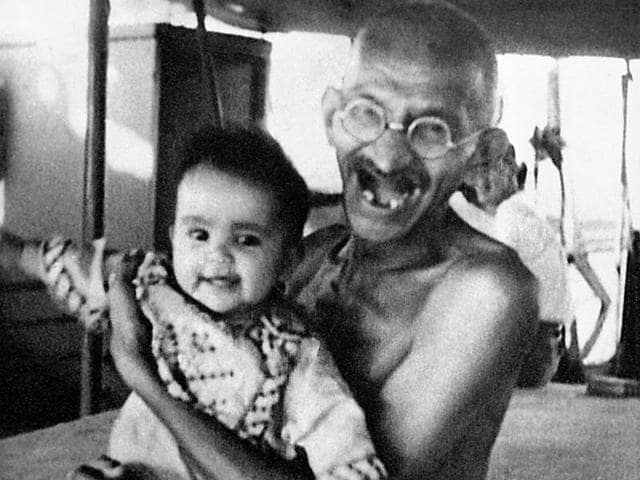 Mahatma Gandhi playing with a child during his voyage on the SS Rajputana to England in 1931.(Dinodia photos)