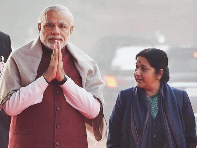 Prime Minister Narendra Modi with external affairs minister Sushma Swaraj at Rashtrapati Bhavan in New Delhi.