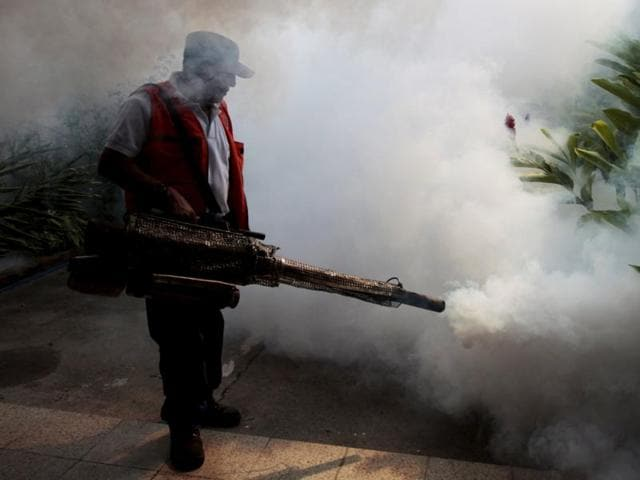 City workers fumigate the Jardines de Merliot neighbourhood as part of preventive measures against the Zika virus and other mosquito-borne diseases in Santa Tecla, El Salvador.