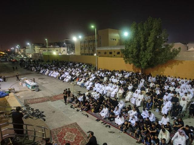 Saudi Shia worshippers gather in a hussainiya, a Shia hall used for commemorations, in the mainly Shia coastal town of Qatif, 400 kms east of Riyadh, on October 16, 2015.  Since deadly attacks claimed by IS last year against Shia mosques in the kingdom's east, security has been increased and community guards now inspect visitors to houses of worship.