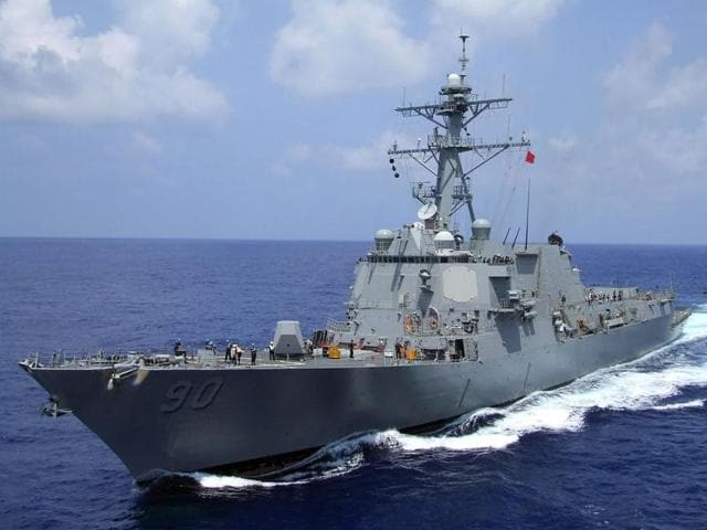 A US Navy guided-missile destroyer sailed within 12 nautical miles of an island claimed by China and two other nations in the South China Sea.