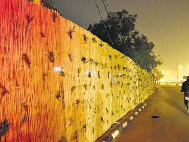 The boundary wall temporarily put up at Hallomajra in Chandigarh before the French President's visit.