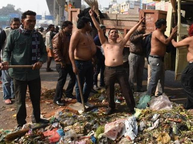 Employees of Delhi's municipal corporations are on a strike in protest against the non-payment of their salaries since the last three months. Workers' protest at Laxmi Nagar Chowk on Saturday, January 30, 2016.