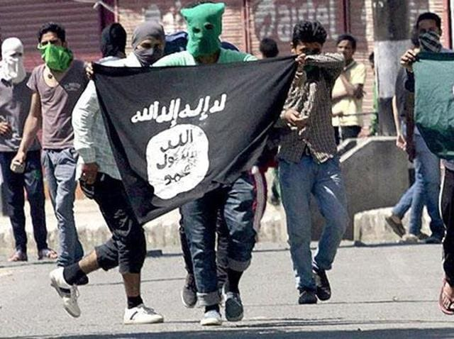 File photo of Kashmiri protesters displaying thePakistani and Islamic State flag during a protest in Srinagar.