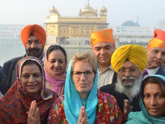 Ontario Premier Kathleen Wynne along with delegation members paying obeisance at Golden Temple in Amritsar on Sunday.