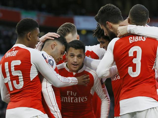 Alexis Sanchez celebrates scoring the second goal for Arsenal during their FA Cup second-round match against Burnley at the Emirates Stadium on January 30, 2016.(Reuters Photo)