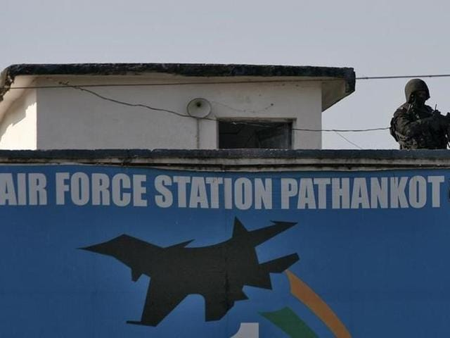 A security personnel stands guard on a building at the Indian Air Force (IAF) base at Pathankot.