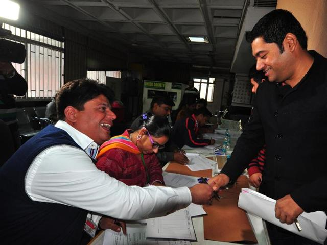 Lokesh Sharma who bagged the second highest bid of Rs 3.31 lakh for VIP number 0009 during auction at RLA office in Sector 17, Chandigarh on Saturday.(Karun Sharma/HT Photo)