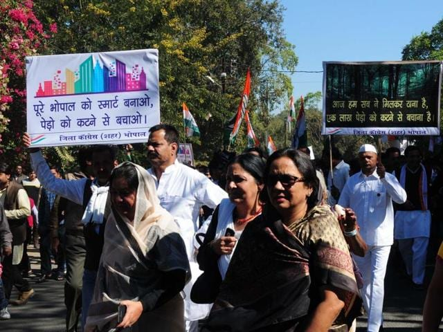 Congress workers protested against the redevelopment of Tulsi Nagar and Shivaji Nagar areas under the Smart City plan to save thousands of trees in the area on December 28, 2015.