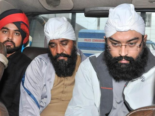 Accused Harbhej Singh and Ranjit Singh (right) in police custody in Jalandhar on Saturday.
