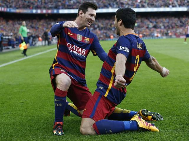 Barcelona's forward Luis Suarez celebrates after scoring the winner during the La Liga match against Atletico Madrid at the Camp Nou stadium in Barcelona on January 30, 2016.