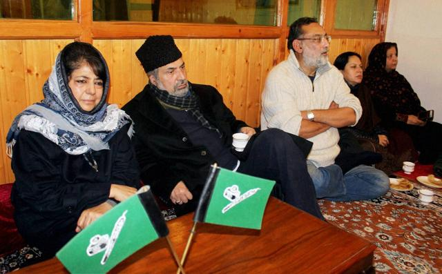 Peoples Democratic Party (PDP) president Mehbooba Mufti along with party senior Vice-President and Memberof Parliament, Muzaffar Hussain Beigh and Jammu and Kashmir Finance Minister, Haseeb Drabu (R) during a party meeting at Mufti residence in Srinagar