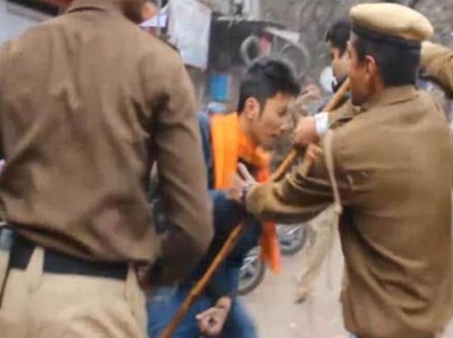 Delhi Police beating the students who were protesting against the suicide of Dalit scholar Rohith Vemula.