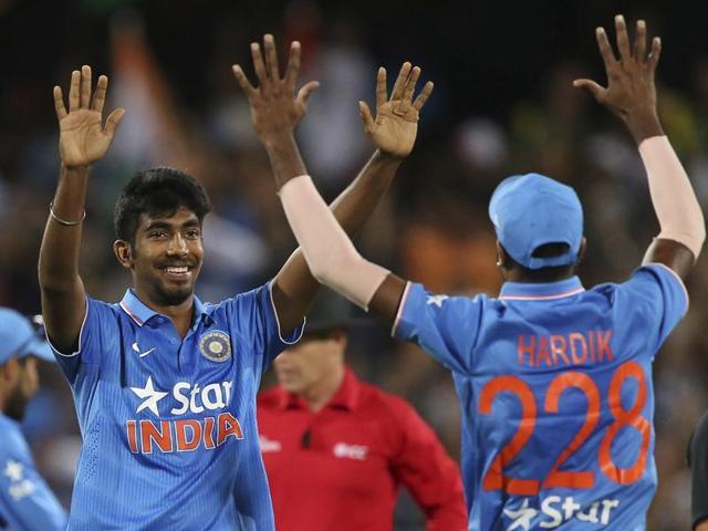India's Jasprit Bumrah and Hardik Pandya celebrate their win during their T20 International cricket match.