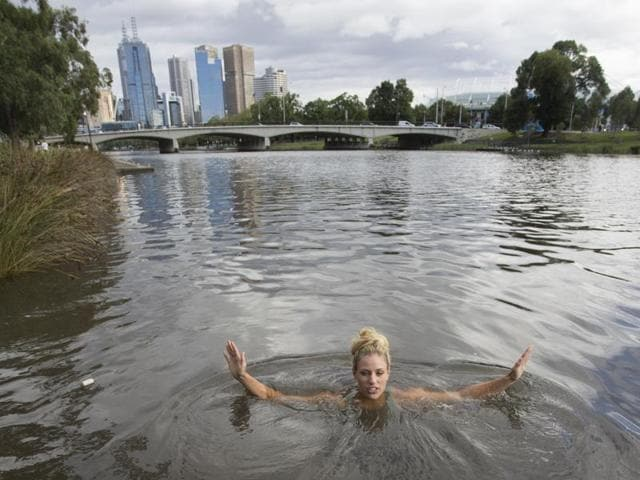 In this photo provided by Tennis Australia, Angelique Kerber of Germany swims in the Yarra River the morning after winning the Australian Open women's singles title.