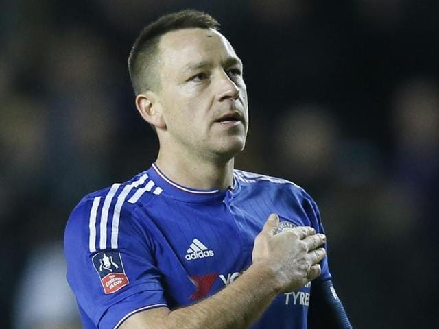 Chelsea's John Terry applauds the fans at the end of the match against MKDons.