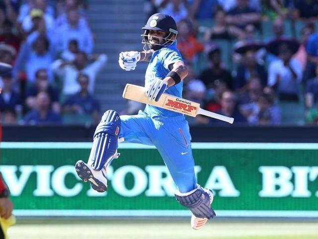 India's Virat Kohli celebrates his century against Australia during their One Day cricket match at the Melbourne Cricket Ground.