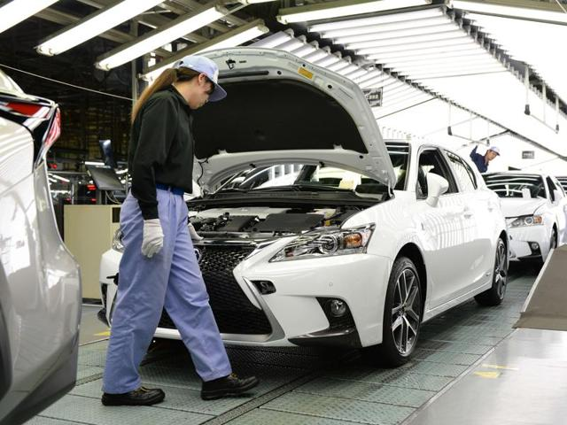 Toyota Motor's subsidiary Toyota Motor Kyushu checking Lexus vehicles on an assembly line at the Miyata Plant in Miyawaka, Fukuoka Prefecture. The motor giant will halt production in Japan following a shortage in supply of parts.