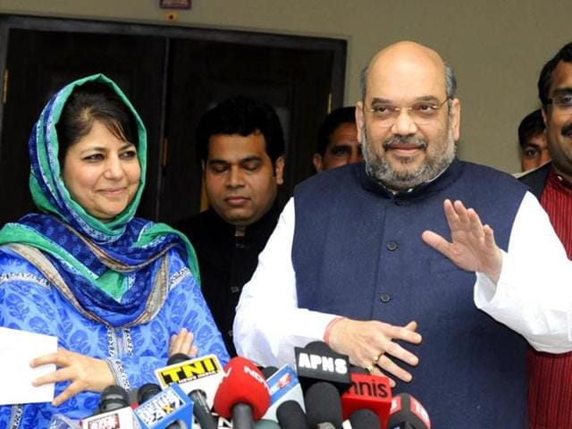BJP president Amit Shah with PDP president Mehbooba Mufti in New Delhi. The Jammu Kashmir governor has given the parties  a day to decide on their alliance to form the state government.