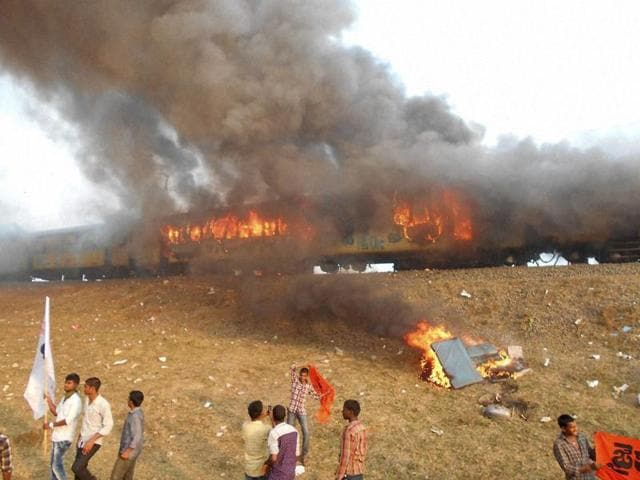 Agitators belonging to the Kapu caste set fire to Ratnachal Express when it halted at Tuni railway station in East Godavari district on Sunday afternoon.