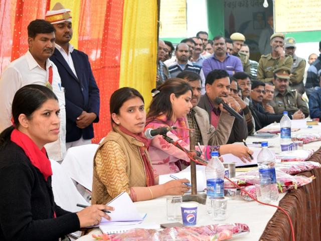 Unnao district magistrate Saumya Agarwal (centre) flanked by the CDO and SDM at a meeting.