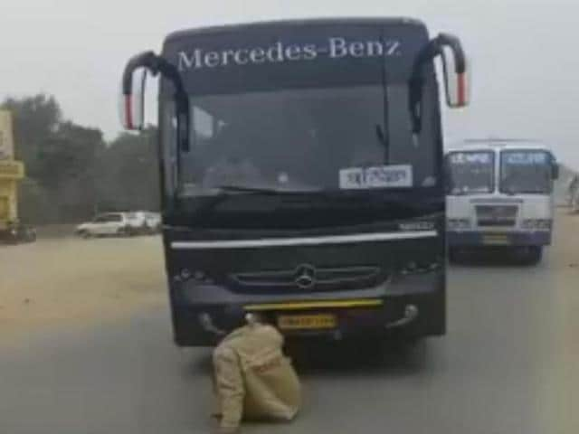 A grab from the video  showing the cop sitting in front of the Badal-owned  Mercedes Benz bus had gone viral on the internet.
