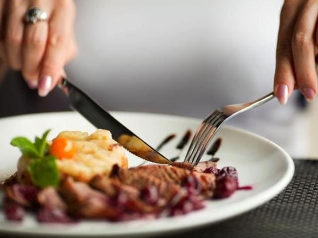 When finished eating, lay the knife and fork close together with the fork on the left, knife on the right with cutting edge facing the fork.