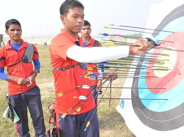 Coach Ashok Yadav instructs archers during a training session at the Robertsganj centre.
