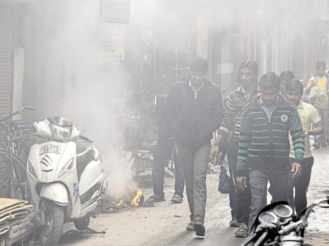 A heap of garbage burns on a street in east Delhi locality. Burning of waste is banned in the Capital.