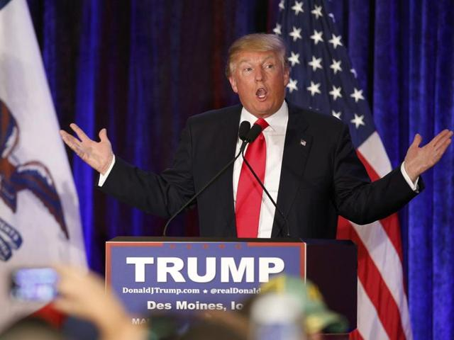 US Republican presidential candidate Donald Trump addresses supporters at his caucus night rally in Des Moines, Iowa.