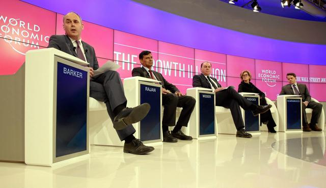 RBI governor Raghuram Rajan (2nd from left) in Davos. The theme of this year's Davos conference was about the fusion of technologies that blur lines between the physical, digital and biological spheres.