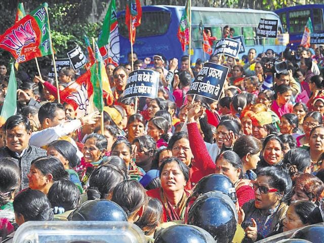Bharatiya Janata Party workers take out huge protests against chief minister Harish Rawat in Dehradun on Monday as he completes two years in office.
