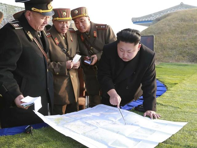 North Korean leader Kim Jong Un watches a rocket firing drill by anti-aircraft units of the Korean People's Army (KPA).