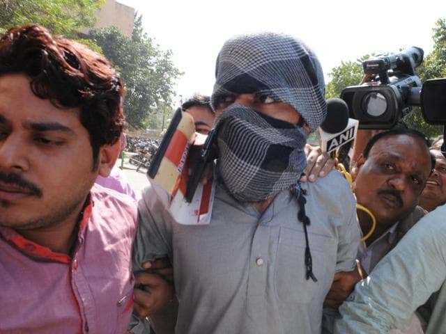 IS suspect Azhar Iqbal being produced at the district court in Bhopal on Tuesday.