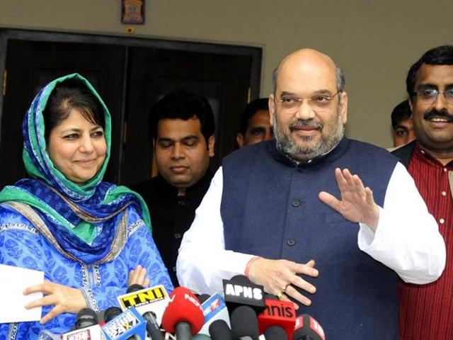 BJP president Amit Shah addresses the media after a meeting with PDP leader Mehbooba Mufti in New Delhi.