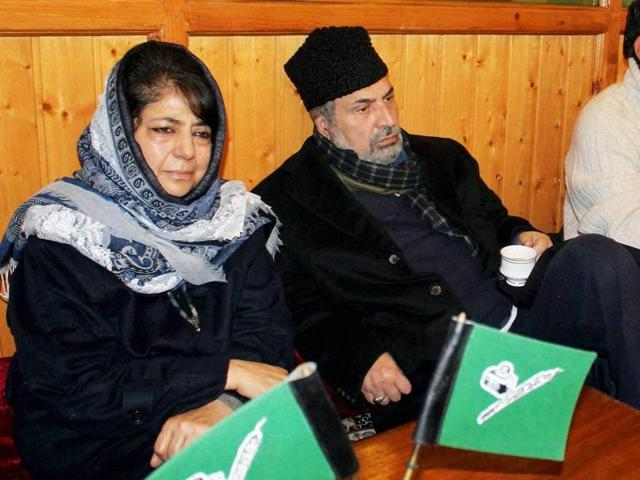 Peoples Democratic Party (PDP) president Mehbooba Mufti along with party senior Vice-President and Memberof Parliament, Muzaffar Hussain Beigh and Jammu and Kashmir Finance Minister, Haseeb Drabu (R) during a party meeting in Srinagar.