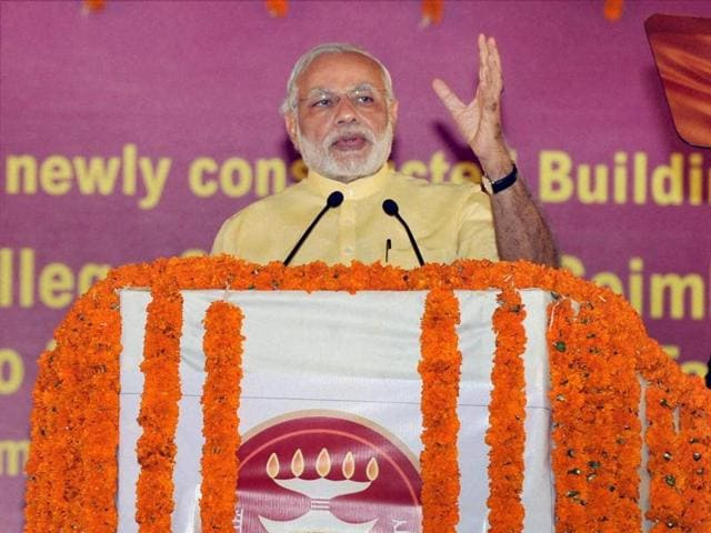 Prime Minister Narendra Modi raises hands with Tamil Nadu BJP leaders at a public meeting in Coimbatore.