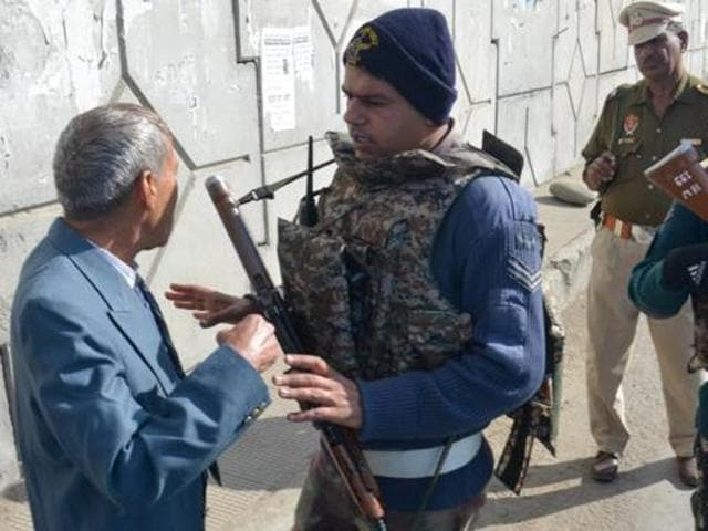 Indian Air force personnel check people before entering Pathankot Air Force Base during Indian Prime Minister Narendra Modi Where an Operation is carried out following the militants attack in Pathankot on Saturday
