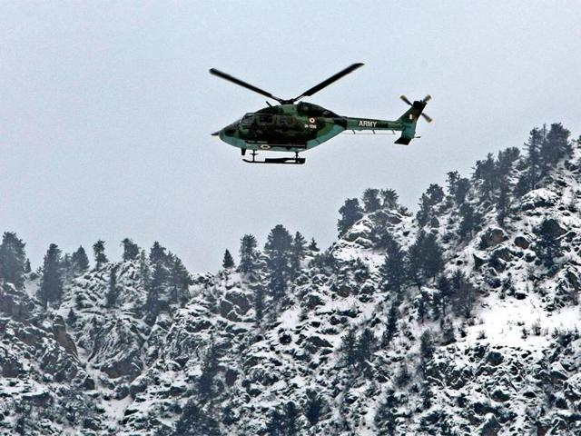 An army chopper on a rescue mission following an avalanche near Gund in Ganderbal district.  Rescuers on Wednesday began searching for 10 soldiers feared buried in an avalanche near the de facto border with Pakistan, an army spokesman said.